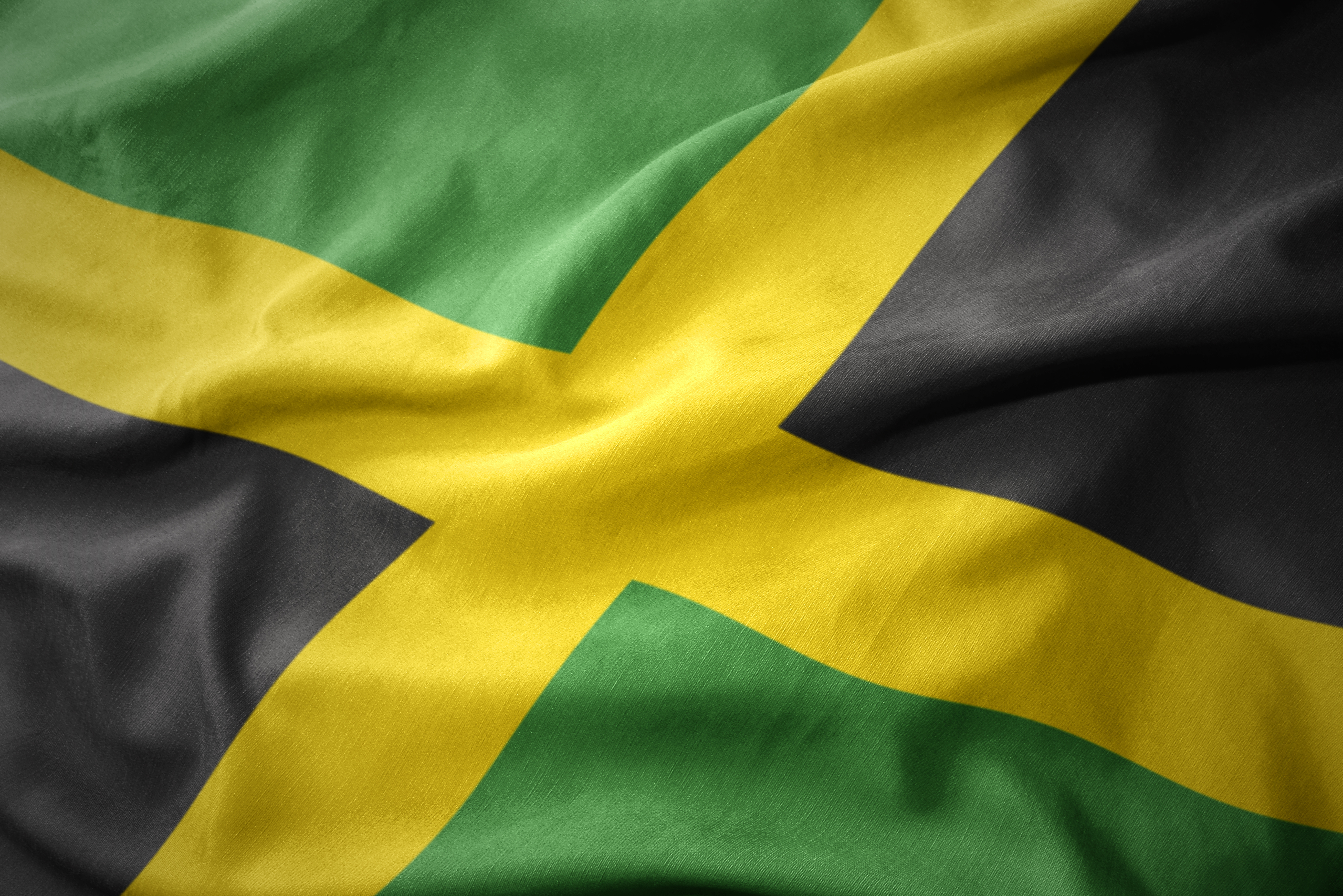 waving colorful national flag of jamaica.