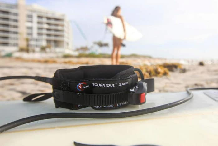 The OMNA tourniquet is wearable as a bracelet/anklet or surfboard leash.