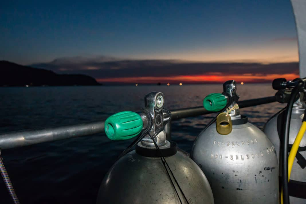 SCUBA tanks on a dive boat prior to a night dive