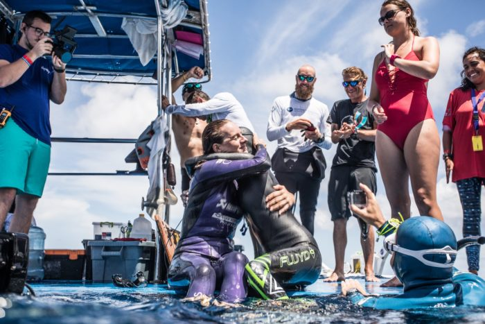 Alessia Zecchini and Alenka Artnik share a hug after jointly setting a new CMAS World Record
