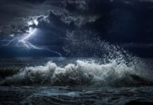 Dark ocean storm with lgihting and waves (Adobe Stock photo)