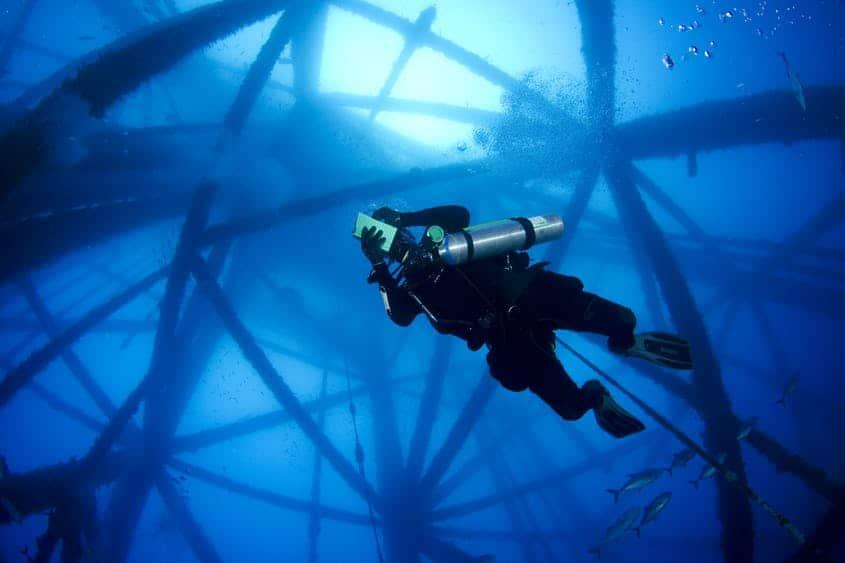 Scuba Diver under an oil rig