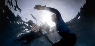 Underwater shot of freedivers training static breath hold.