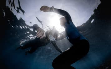 Underwater shot of freedivers training static breath hold.