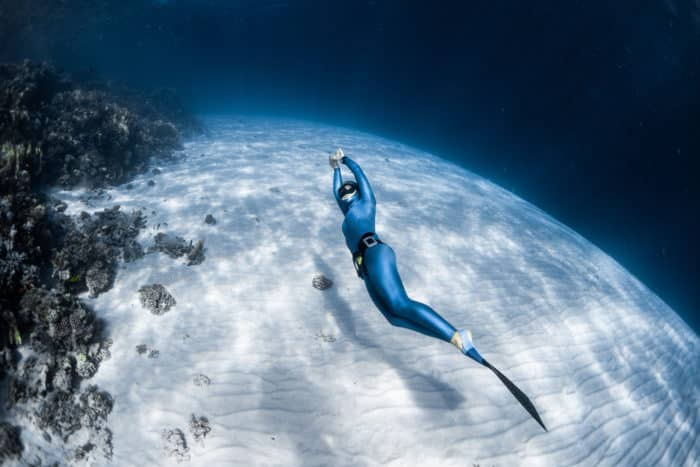 Freediver dolphin kicking using a monofin