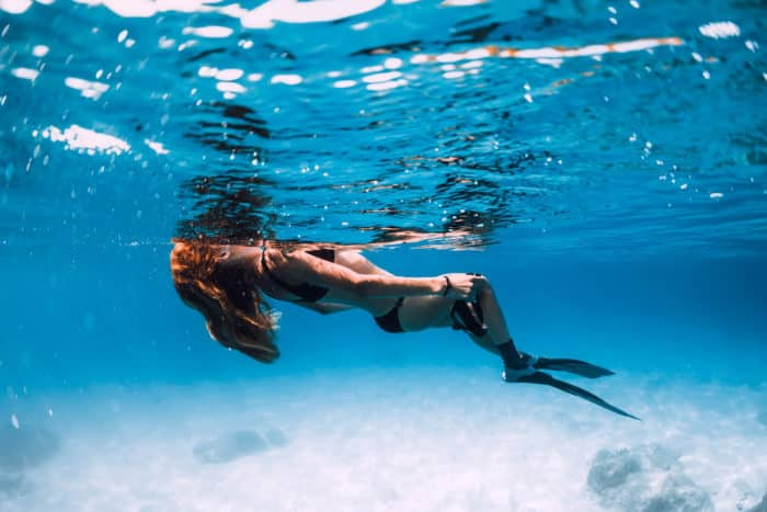 Woman freediver relaxing on the surface.