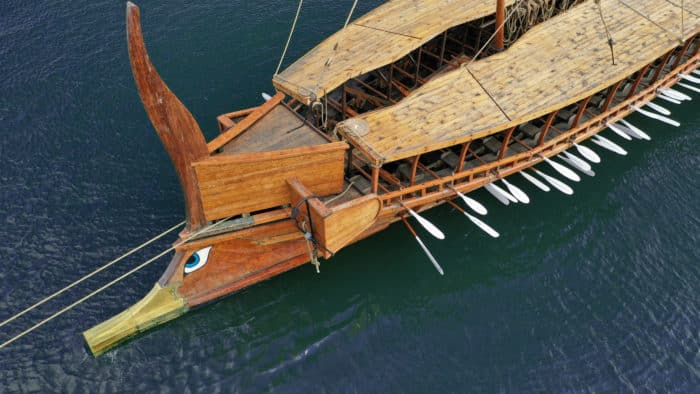Aerial detail photo of ancient Greek warship full scale replica Trireme in port of Faliron, Attica, Greece