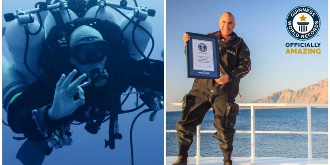 Ahmed Gabr holding the Guinness World Record certificate for his dive