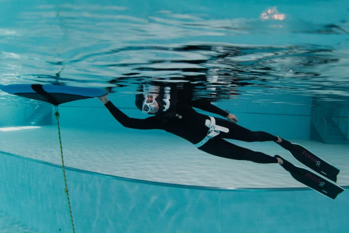 Preparing for a dive in the Fourth Element RF1 Freediving wetsuit
