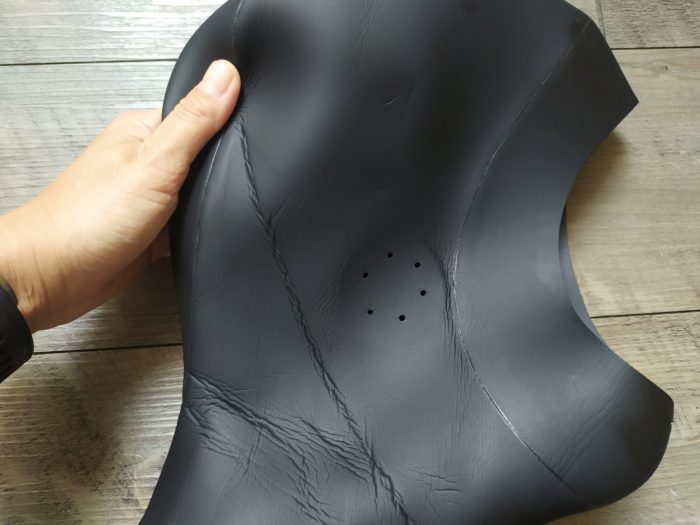 Premade ear holes on the Fourth Element freediving RF Vest 3mm