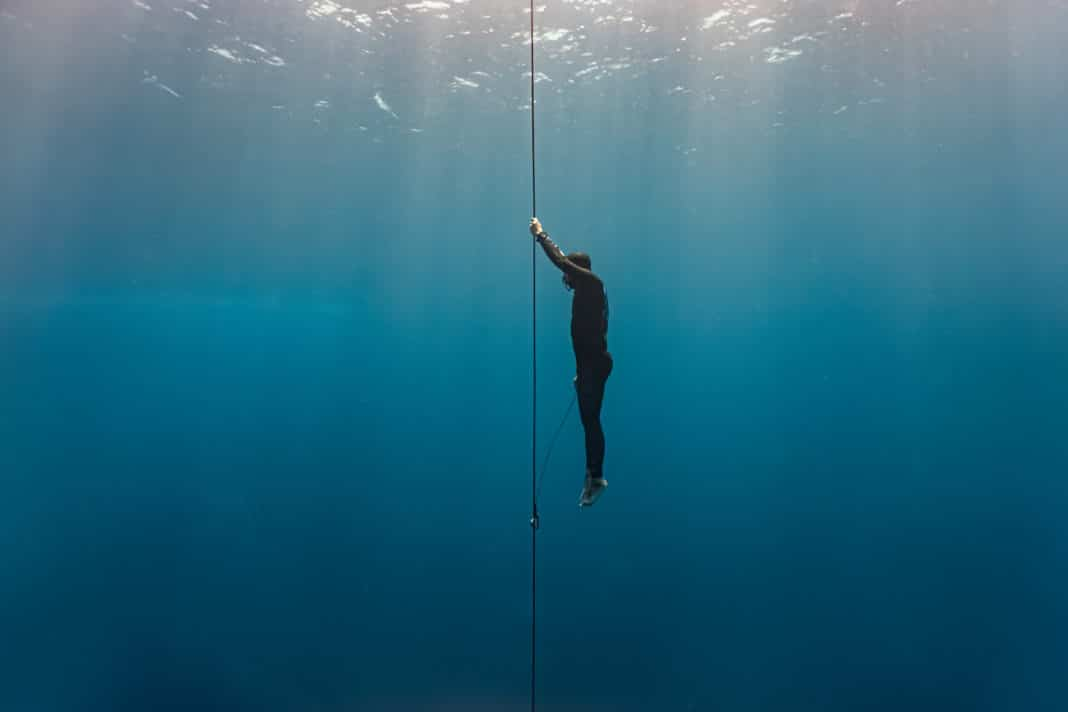 Freediver ascends to the surface by pulling the dive line