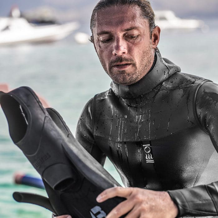 The RF1 vest shown over the RF1 suit, giving additional warmth whilst freediving and made with limestone neoprene. Photo Credit: Fourth Element