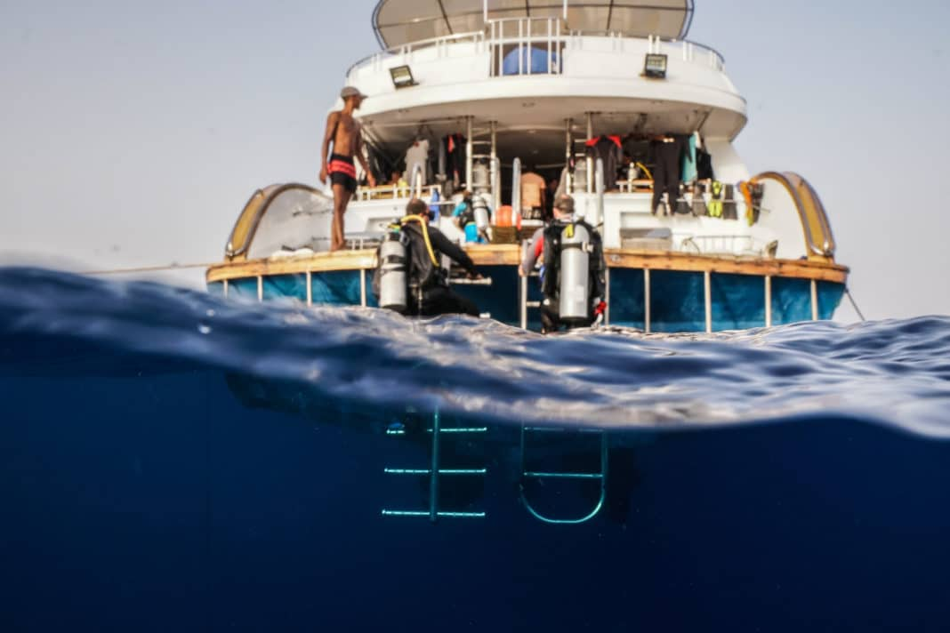 Scuba Divers getting back on a liveaboard after a dive in the Red Sea