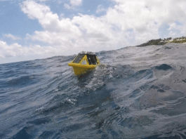 A solar-powered, IoT-enabled Sofar Spotter buoy off the coast of Bermuda, measuring waves, winds and sea surface temperatures. (Image credit: Ted Gosling / One Communications)